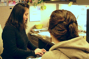 Niki Carpenter, left, helps an Oregonian receive economic assistance in the Bend DHS office.