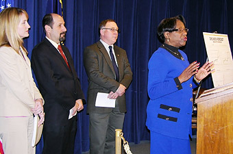 Sen. Margaret Carter speaks at news conference Thursday; with her are Erinn Kelley-Siel, Dr. Goldberg, Rep. Peter Buckley.