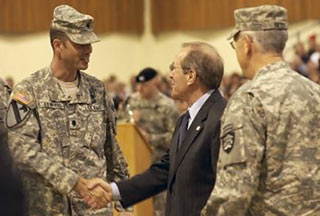 Gov. Kulongoski greets Maj. William Edwards at the National Guard's 41st Brigade Combat Team's deployment ceremony in May.