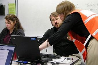 Karen Bishop, Michael Kuebler, Julie Plagenoff, DHS Public Health Division, at the AOC.